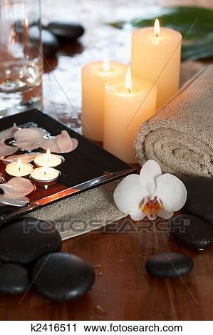 stock photography of relaxing spa with candles orchids towels and
