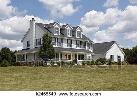 Suburban Home With Blue Shutters And Wraparound Porch Stock Photo K2465549 Fotosearch
