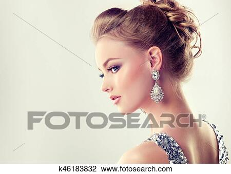 Stock Photo Of Young Gorgeous Girl In A Profile Dressed In Evening