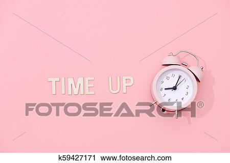 705d440d12a648 Stock Photography - TIME UP text with light pink retro alarm clock with  shadow on pink