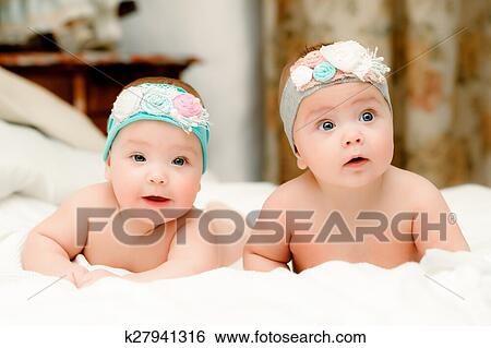 Stock Image - Two twin babies 20f6217319d