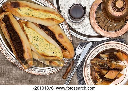40cf59e874f5fa Stock Images of Turkish savory pide served with hot fresh tea ...