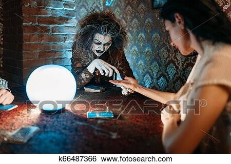 Foreteller guessing by hand over a crystal ball Stock Photograph