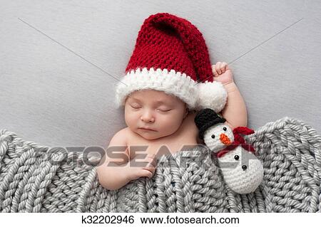 Stock Images of Newborn Baby Boy with Santa Hat and Snowman Plush ... e2bb414945d