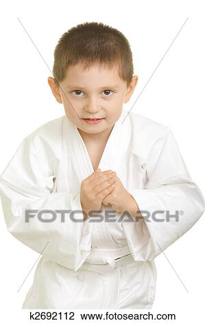 Stock photo of karate boy in greeting bow k2692112 search stock stock photo karate boy in greeting bow fotosearch search stock photography print m4hsunfo