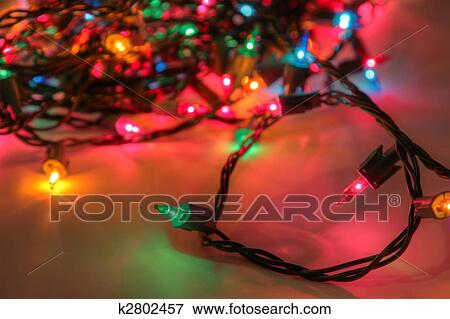 an hdr high dynamic range shot of a muli colored christmas light string