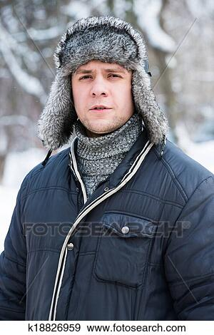 f1398ed5b51 Stock Photograph - man in a fur winter hat. Fotosearch - Search Stock  Photography