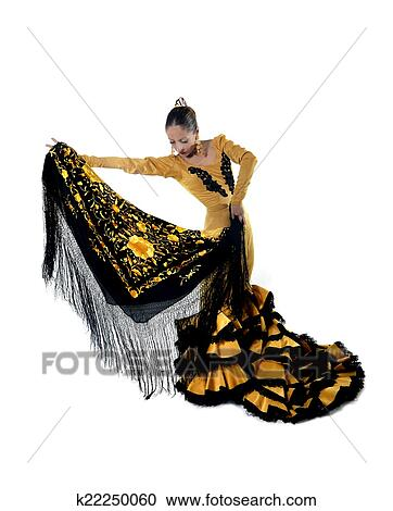 f53961bcd99c Young spanish woman dancing Sevillanas wearing typical folk gold and black  tailed gown dress and shawl in flamenco traditional dance of Spain concept  ...
