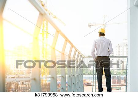 9a8fb95c102 Picture - Back side of Asian Indian male site contractor engineer.  Fotosearch - Search Stock