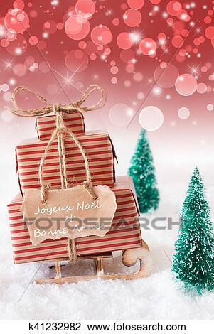 Auguri Di Buon Natale E Felice Anno Nuovo In Francese.Verticale Natale Sleigh Sfondo Rosso Bonne Annee Mezzi Anno Nuovo Archivio Immagini