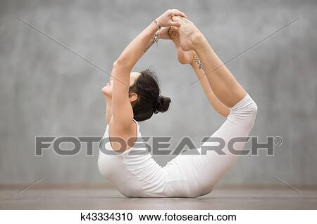beautiful yoga dhanurasana pose stock image  k43334310