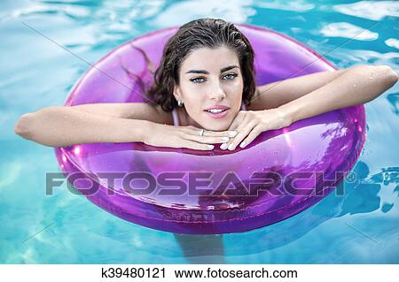 Model in rubber ring in swimming pool Stock Image ...