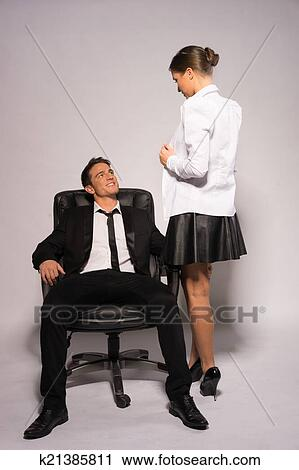 stock photography of two young couple in corporate attire talking