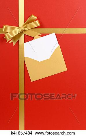 Christmas Invitation Background Gold.Red Background Gold Christmas Gift Ribbon Bow With Blank Invitation Or Greetings Card Vertical Picture