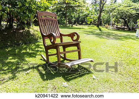 Empty rocking chair over grass at summer sunset & Stock Photo of Empty rocking chair over grass k20941422 - Search ...