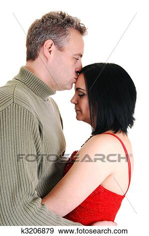 A Middle Age Husband Gives He Wife Kiss Of Honor On Her Foreheadand Holts In His Arms White Background