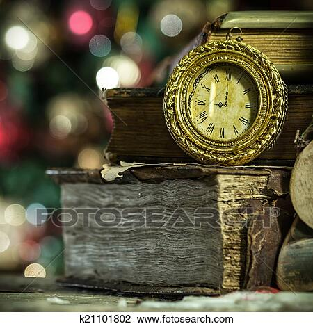 Old Books Antique Clock Candle Stock
