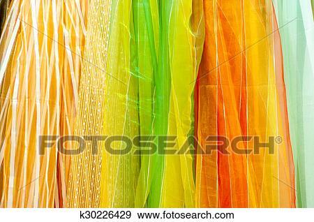 https://fscomps.fotosearch.com/compc/CSP/CSP330/kleurrijke-doorschijnend-gordijn-stock-fotografie__k30226429.jpg
