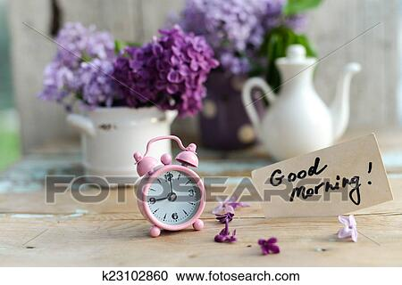 stock photography of two tone lilac flowers with good morning note