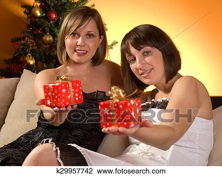 Friends Exchanging Christmas Presents Stock Image K29957742