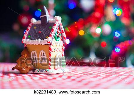 Christmas Gingerbread House Background.Cute Gingerbread Cookie And Candy Ginger House Background Christmas Tree Lights Stock Photo