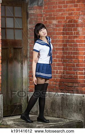 Stock Photo Asian Schoolgirl Standing In Front Of School Fotosearch Search Stock Photography