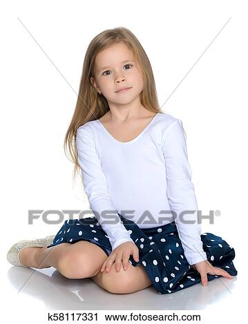 Little girl is sitting on the floor