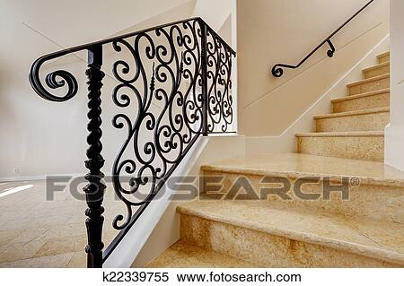 Emtpy House Interior With Shiny Tile Floor. Marble Staircase With Black  Wrought Iron Railing