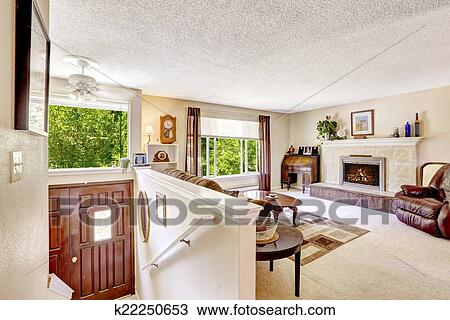 Luxury Living Room Wih Stairs To Entrance Hallwa Fotosearch
