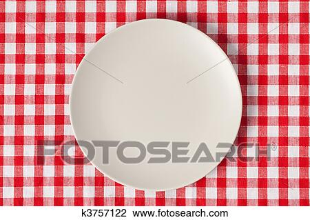 Stock Photo   Plate On Checkered Table Cloth. Fotosearch   Search Stock  Photography, Print