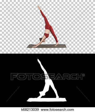 beautiful young woman wearing red sportswear doing yoga or