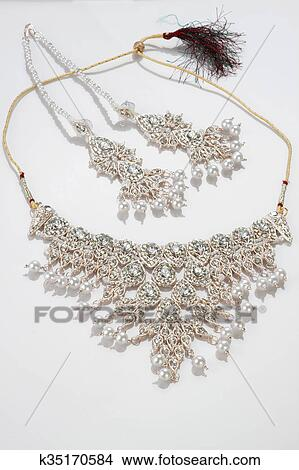 Modern Intricate Indian Jewelry Diamond Necklace Set On White