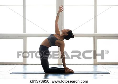 young attractive yogi woman practicing yoga doing