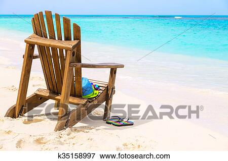 Picture Wooden Beach Chair With Hat And Slippers Sungles At Tropical Summer