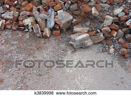 Factory demolition stone stack of rubble on concrete floor Stock Photo