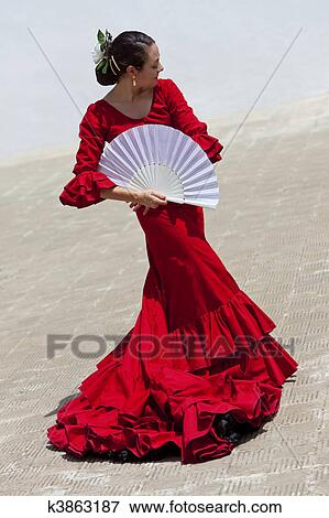 0f9113dbcaf9 Stock Photo - Traditional Woman Spanish Flamenco Dancer In Red Dress With  Fan. Fotosearch
