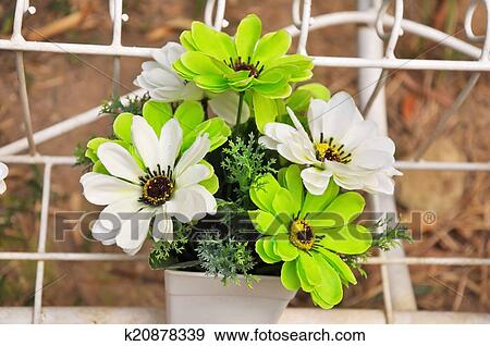 Stock Photograph Of Green And White Plastic Flowers K20878339