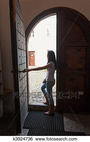 Stock Images Of Woman Walks Out A Door K3924736 Search Stock