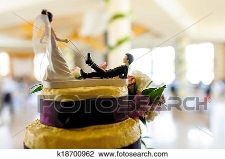 Funny Wedding Cake Docoration Tied Groom On Bride S Leash Drawing K18700962 Fotosearch