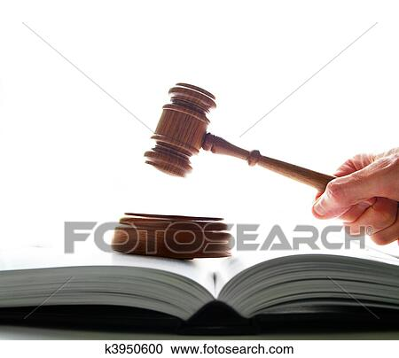 stock photography of judges court gavel being pounded on a lawbook