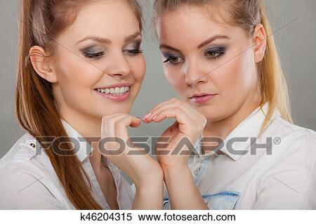 stock image of two woman nake heart gesture k46204315 search stock