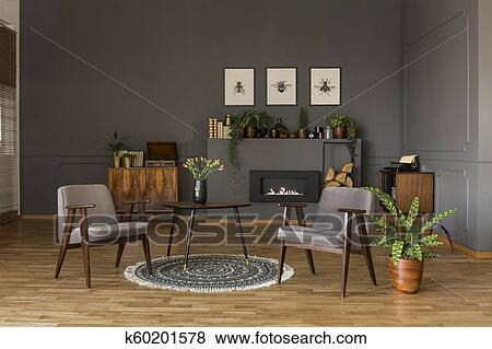 Pictures Of Table With Tulips On Rug Between Grey Armchairs In Retro