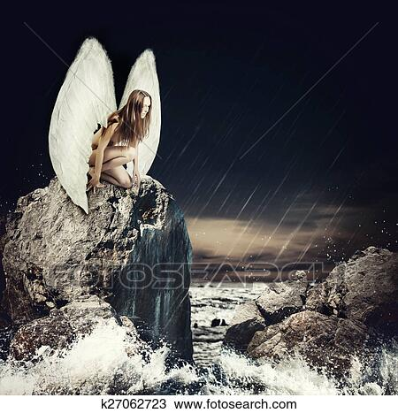 Sad woman angel with white wings Stock Image