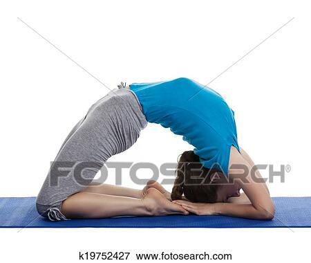 yoga  young beautiful woman yoga instructor doing pigeon