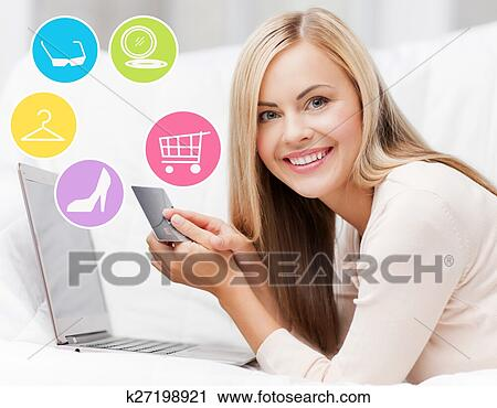 stock photography of happy woman with laptop and credit card
