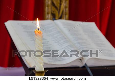 stock photo of opened bible and candle k51328354 search stock
