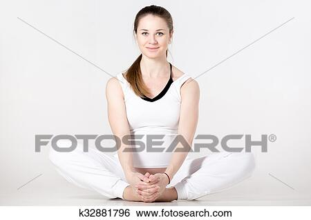 prenatal yoga butterfly pose stock photograph  k32881796