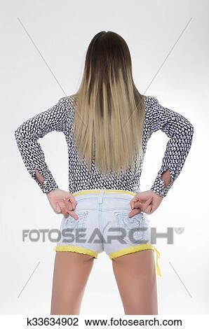 Sportliche Mädchen In Jeans Kurze Hosen Mit Anfall Esel