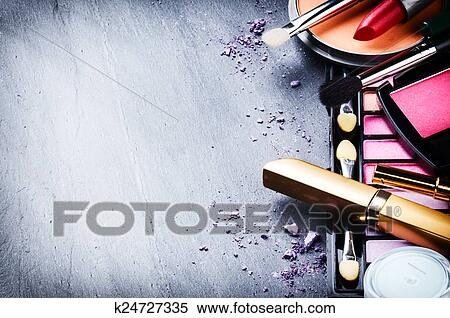 Various makeup products on dark background Stock Photography