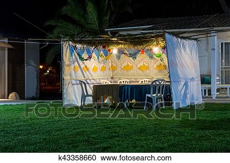 Fabric sukkah decorated with printed pattern and hebrew text of blessing Grant peace everywhere goodness and blessing Grace lovingkindness and mercy to ... & Stock Photography of Sukkah - symbolic temporary hut for celebration ...